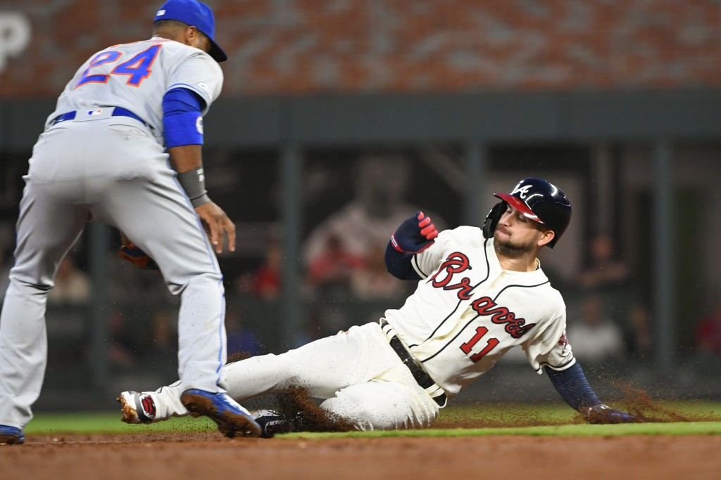 Atlanta Braves center fielder Ender Inciarte (11) steals second base with New York Mets second baseman Robinson Cano moving to attempt a tag during th
