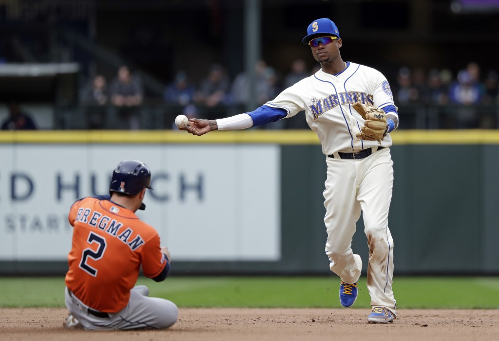 Seattle Mariners shortstop Tim Beckham, right, throws to first after forcing out Houston Astros' Alex Bregman (2) at second base in the eighth inning