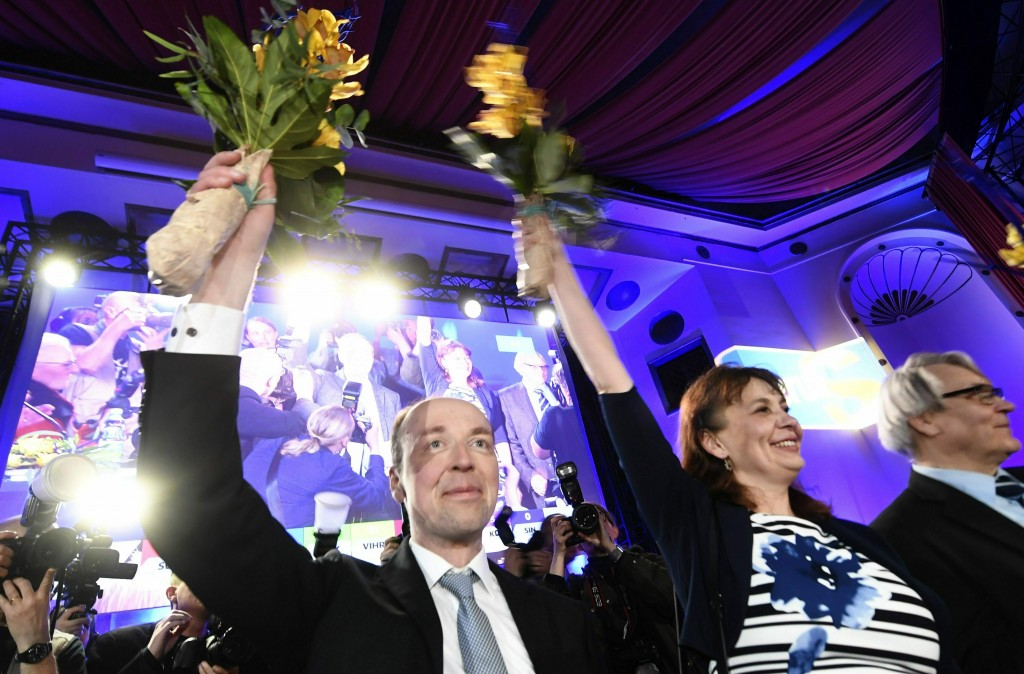 Chairman of The Finns Party Jussi Halla-aho, left, Party Secretary Riikka Slunga-Poutsalo and Campaign manager Ossi Sandvik, right, attend The Finns P...