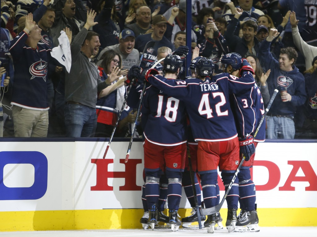Columbus Blue Jackets' players celebrate their goal against the Tampa Bay Lightning during the second period of Game 3 of an NHL hockey first-round pl