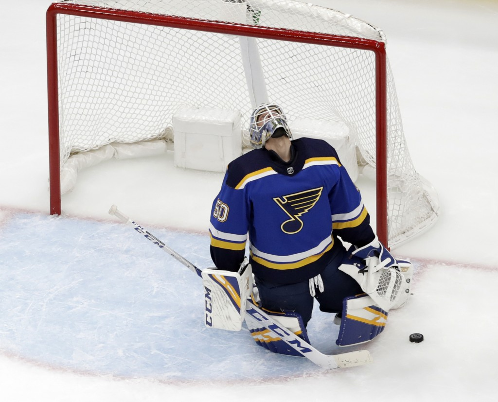 St. Louis Blues goaltender Jordan Binnington reacts after giving up a goal to Winnipeg Jets' Patrik Laine, of Finland, during the second period in Gam...
