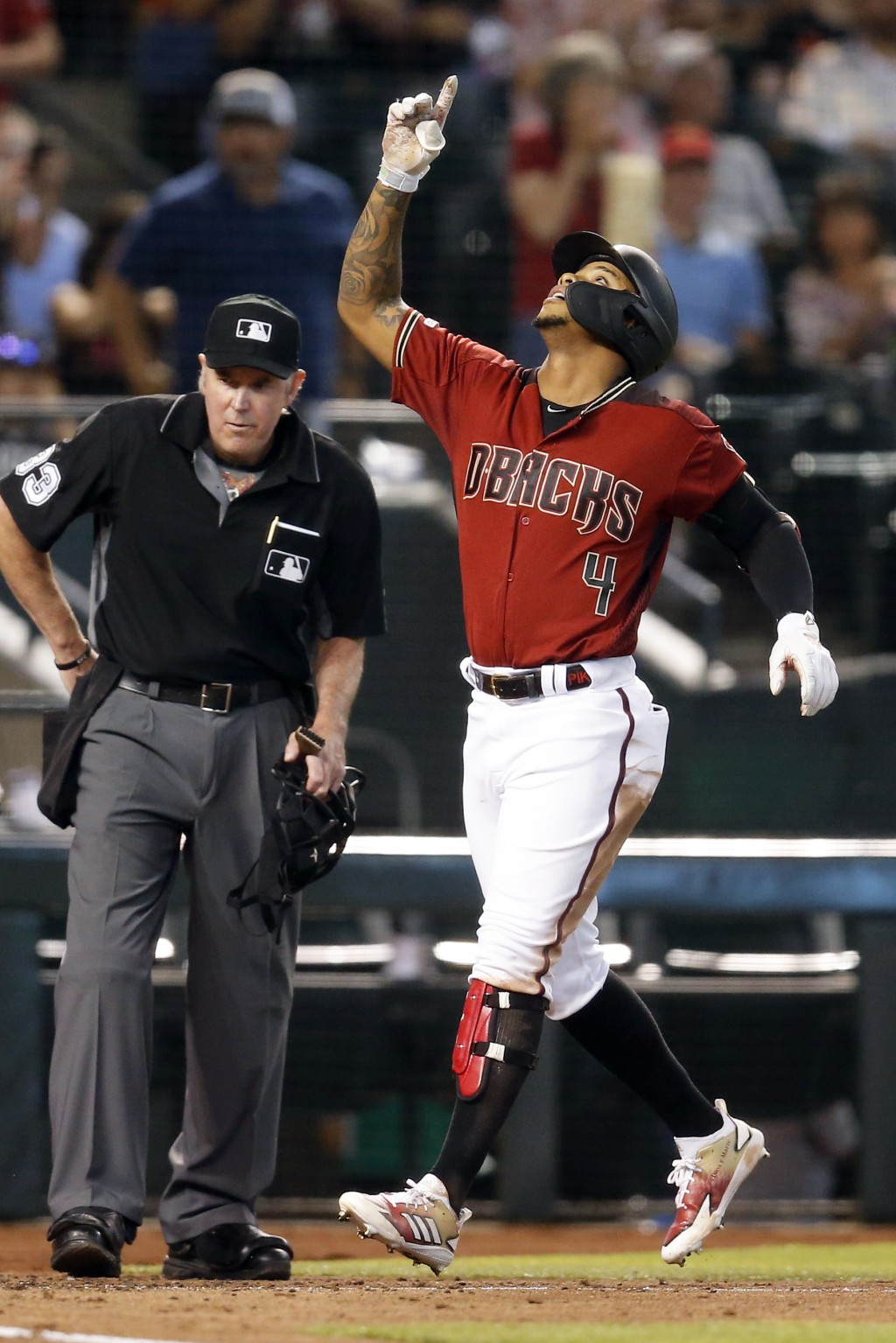 Arizona Diamondbacks' Ketel Marte (4) celebrates after hitting a two-run home run against the San Diego Padres in the third inning during a baseball g
