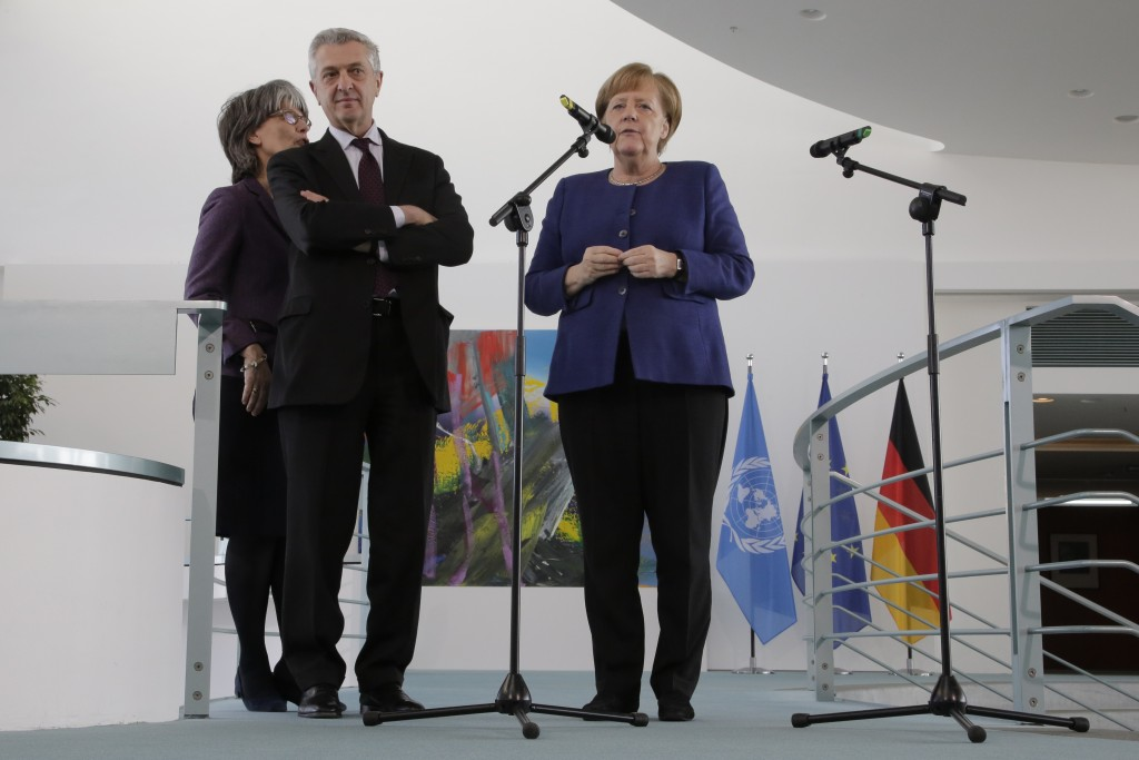 German Chancellor Angela Merkel, right, United Nations High Commissioner for Refugees Filippo Grandi, center, brief the media prior to a meeting at th