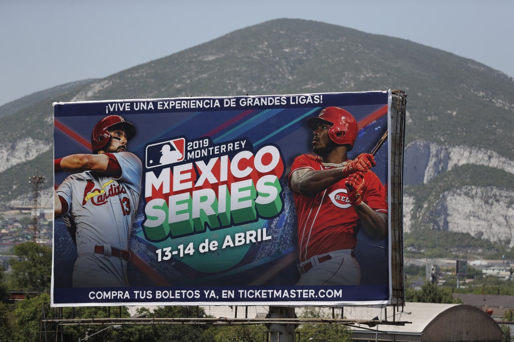 A billboard advertising the Mexico Series between the Cincinnati Reds and the St. Louis Cardinals stands outside the stadium before the start of their