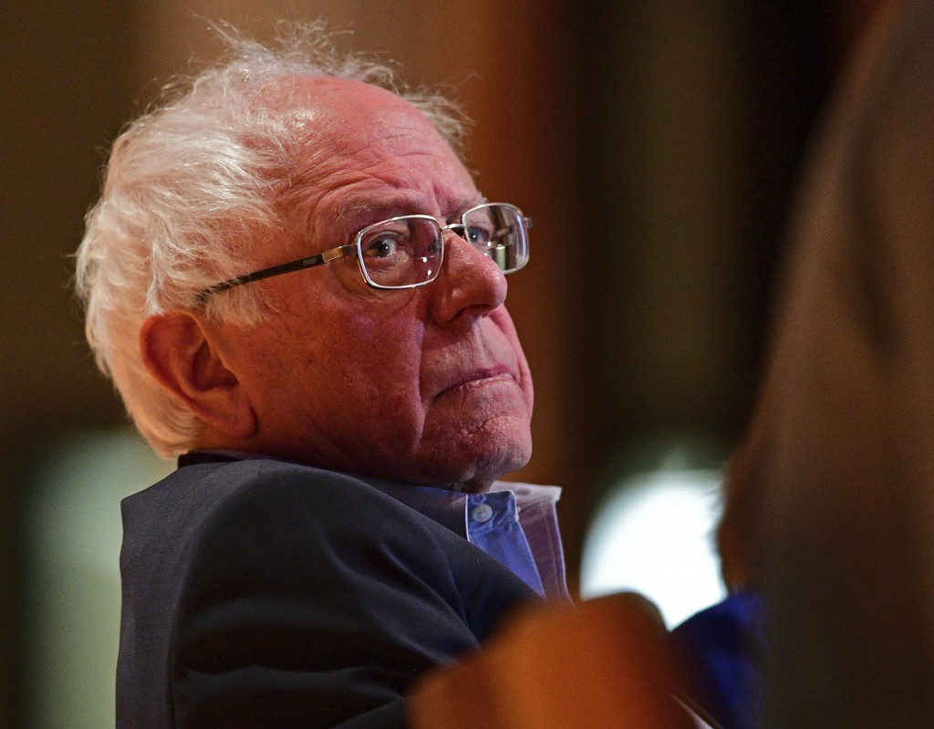 Sen. Bernie Sanders, I-Vt., sits before speaking at an Ohio workers town hall meeting, Sunday, April 14, 2019, in Warren, Ohio. (AP Photo/David Dermer