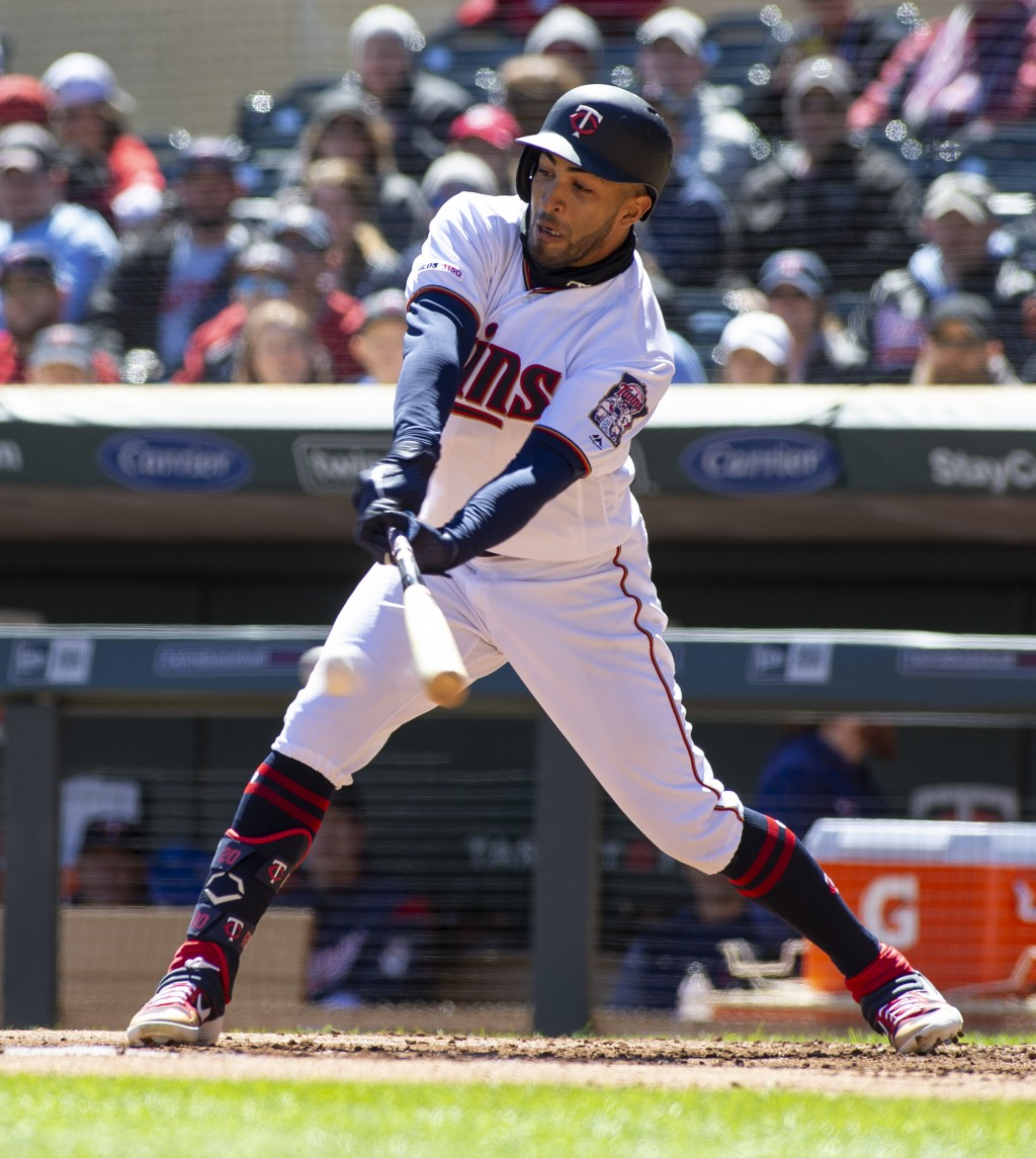 Minnesota Twins' Eddie Rosario connect for an RBI-single against the Detroit Tigers during the first inning of a baseball game Sunday, April 14, 2019,...