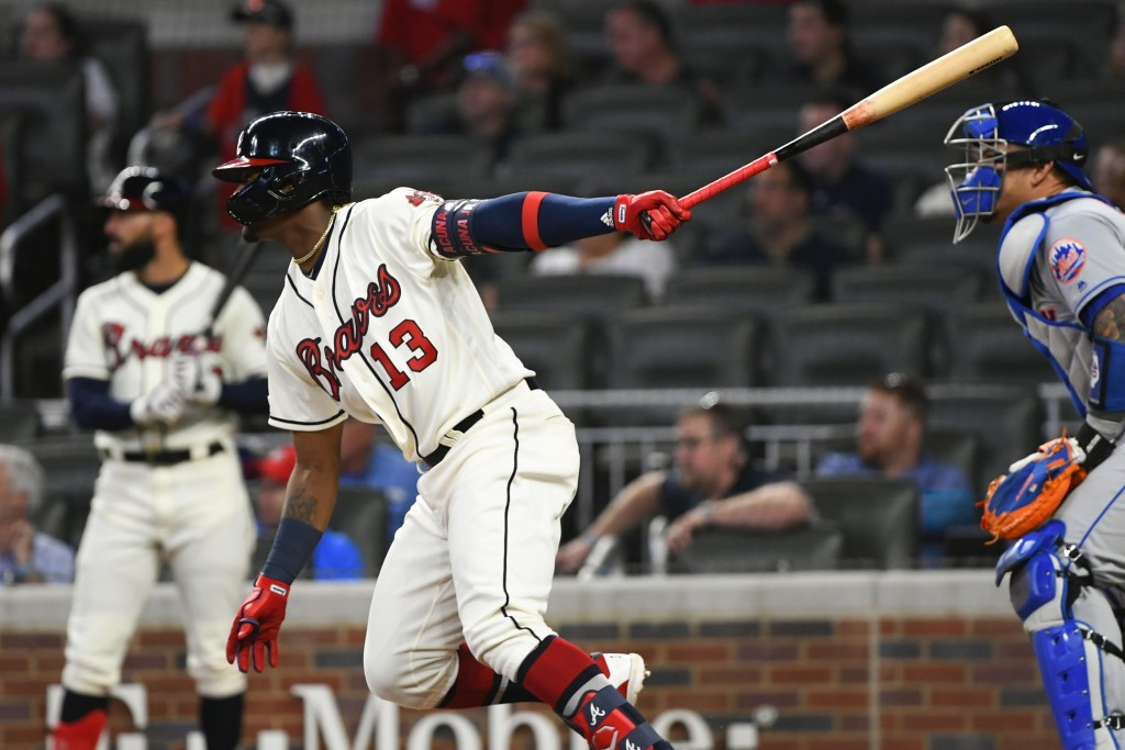 Atlanta Braves' Ronald Acuna Jr. watches his one-run single line drive to right field during the third inning of a baseball game against the New York