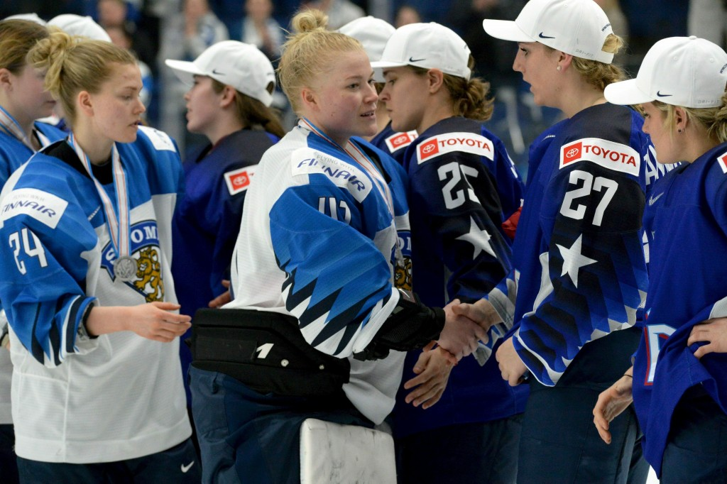 Goalkeeper Noora R'ty (41) of Finland followed by Noora Tulus (24) congratulates US players for their 2-1 shootout victory after the IIHF Women's Ice