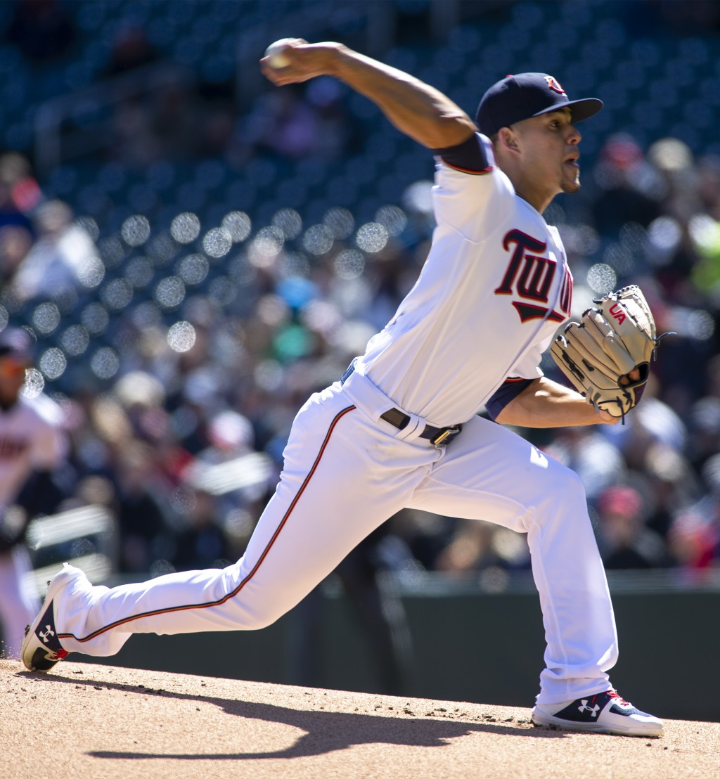 Minnesota Twins starting pitcher Jose Berrios (17) delivers against the Detroit Tigers during the first inning of a baseball game Sunday, April 14, 20...