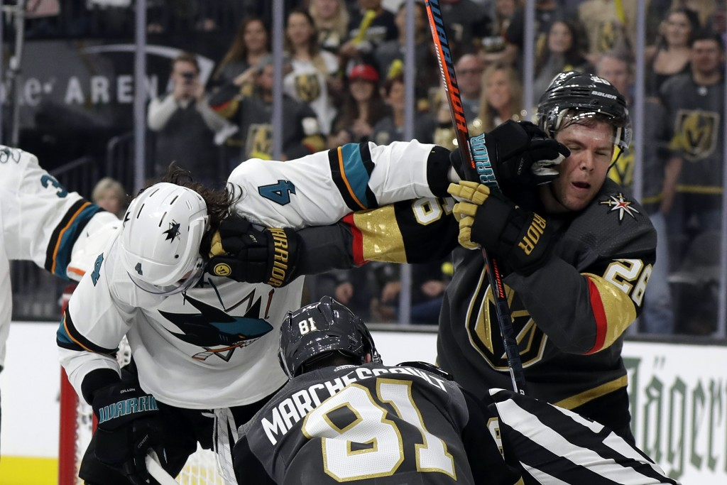 San Jose Sharks defenseman Brenden Dillon (4) and Vegas Golden Knights center Paul Stastny (26) trade punches during the second period of Game 3 of an