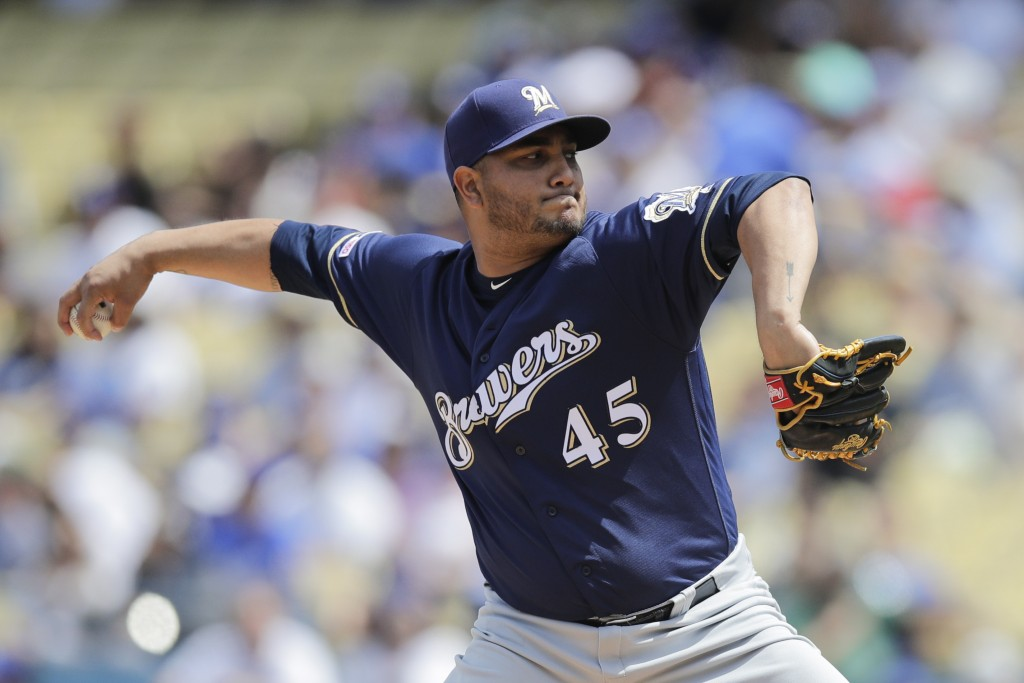 Milwaukee Brewers starting pitcher Jhoulys Chacin throws against the Los Angeles Dodgers during the first inning of a baseball game, Sunday, April 14,