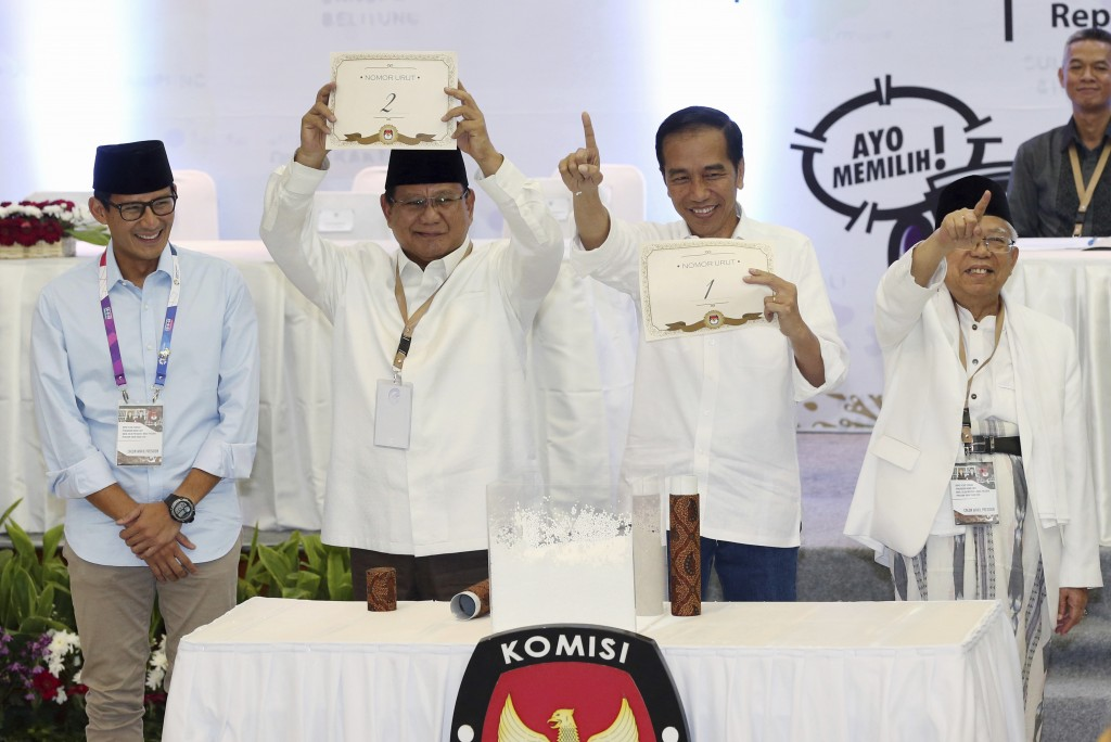 FILE - In this Sept. 21, 2018, file photo, Indonesian presidential candidates Prabowo Subianto, second from left, and his running mate Sandiaga Uno, l