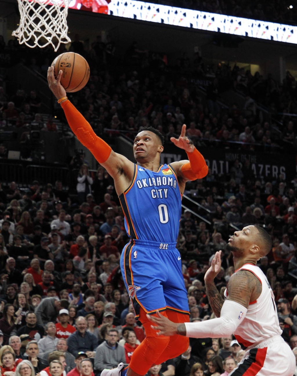 Oklahoma City Thunder guard Russell Westbrook, left, shoots as Portland Trail Blazers guard Damian Lillard, right, defends during the first half of Ga