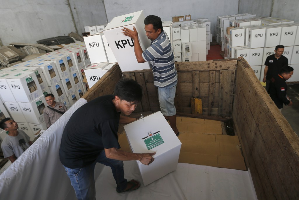 Electoral workers load ballot boxes into a truck to be distributed to polling stations on the outskirts of Jakarta, Indonesia, Monday, April 15, 2019.