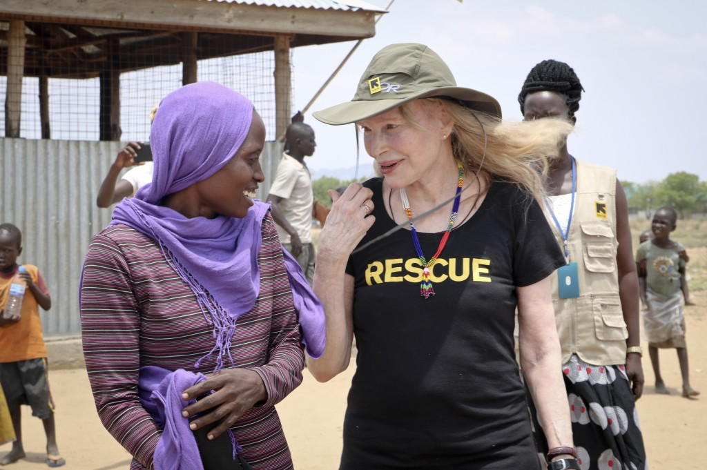 In this photo taken Tuesday, April 2, 2019, human rights activist Mia Farrow laughs with staff from the International Rescue Committee while visiting
