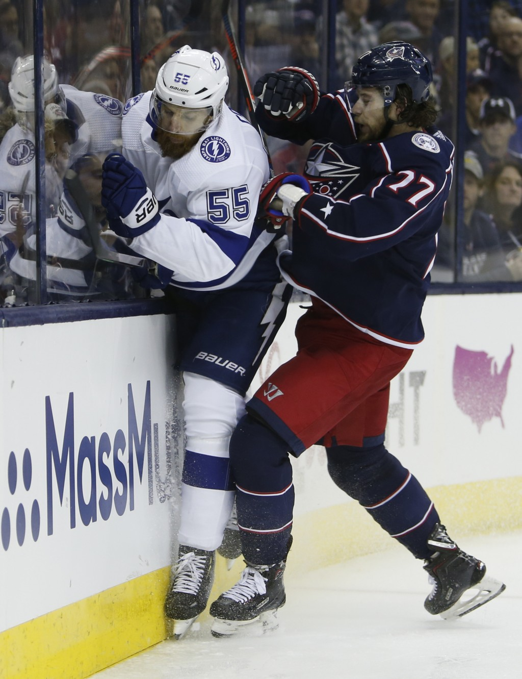 Columbus Blue Jackets' Josh Anderson, right, checks Tampa Bay Lightning's Braydon Coburn during the second period of Game 3 of an NHL hockey first-rou