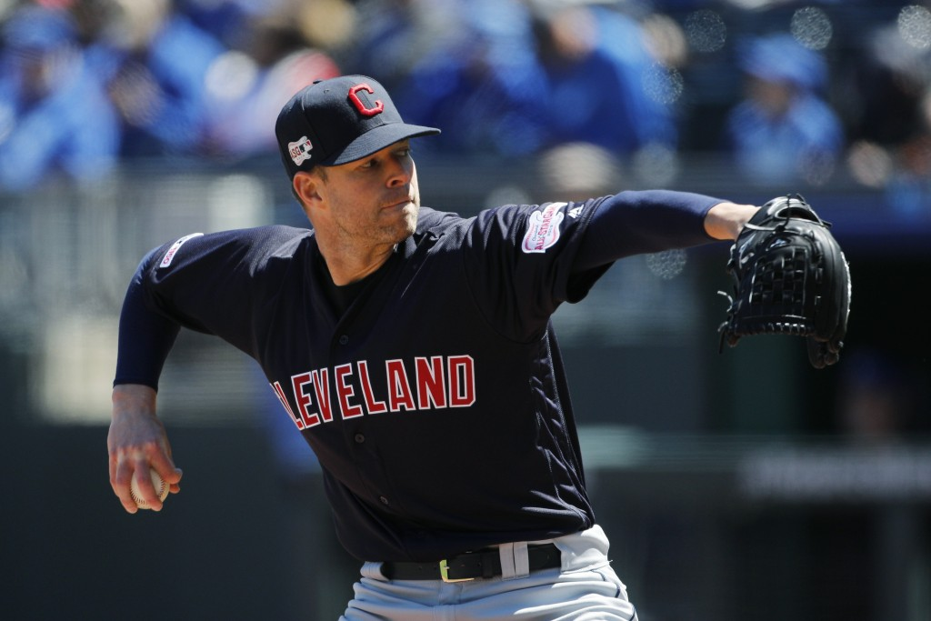 Cleveland Indians pitcher Corey Kluber throws to a Kansas City Royals batter in the first inning of a baseball game at Kauffman Stadium in Kansas City