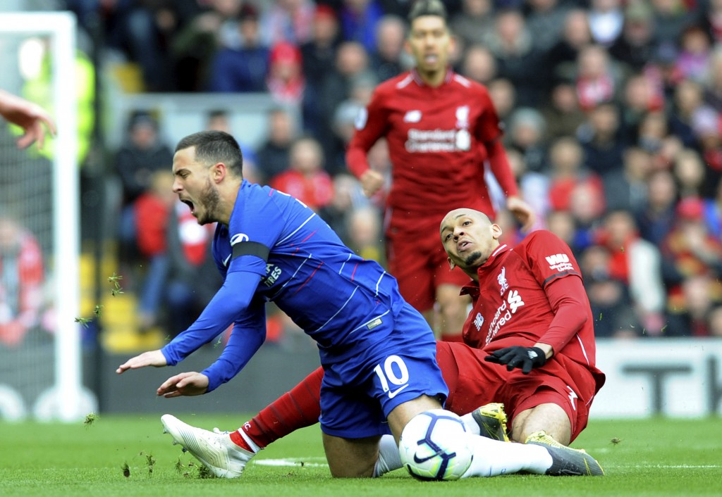 Chelsea's Eden Hazard, left, duels for the ball with Liverpool's Fabinho during the English Premier League soccer match between Liverpool and Chelsea
