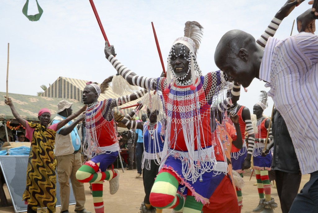 In this photo taken Tuesday, March 26, 2019, South Sudanese perform a traditional dance as they welcome donors who were launching a new joint educatio