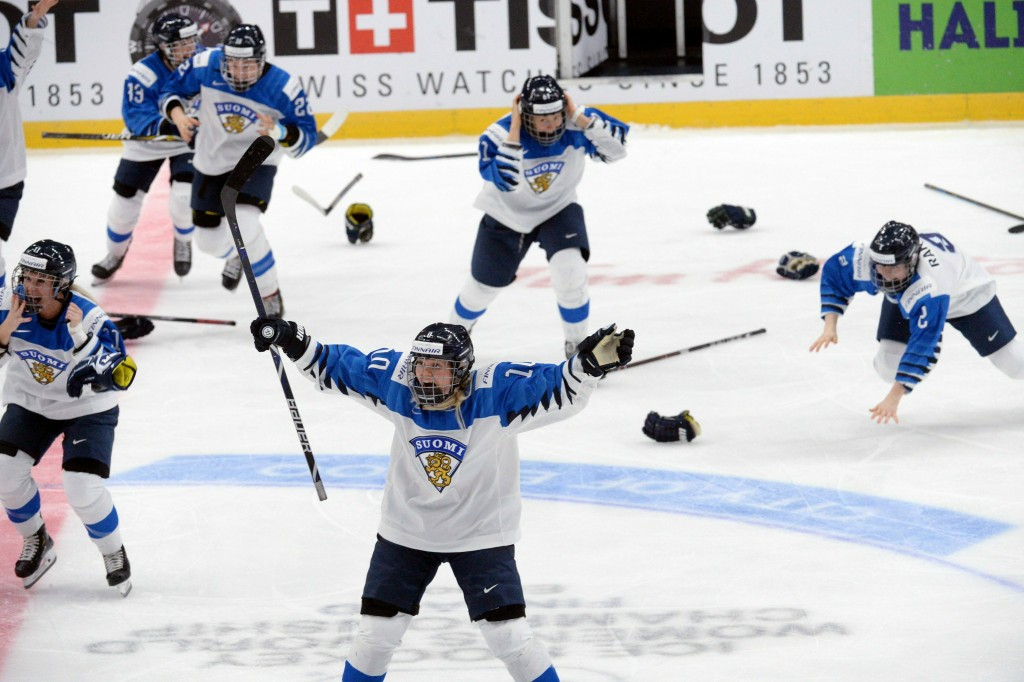 Finnish players celebrate a game-winning overtime goal which was later disallowed during the IIHF Women's Ice Hockey World Championships final match b