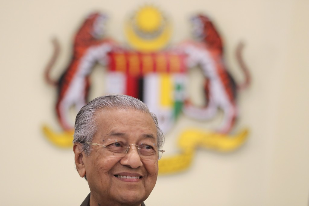 Malaysian Prime Minister Mahathir Mohamad smiles during a press conference in Putrajaya, Malaysia, Monday, April 15, 2019. Malaysia's government decid
