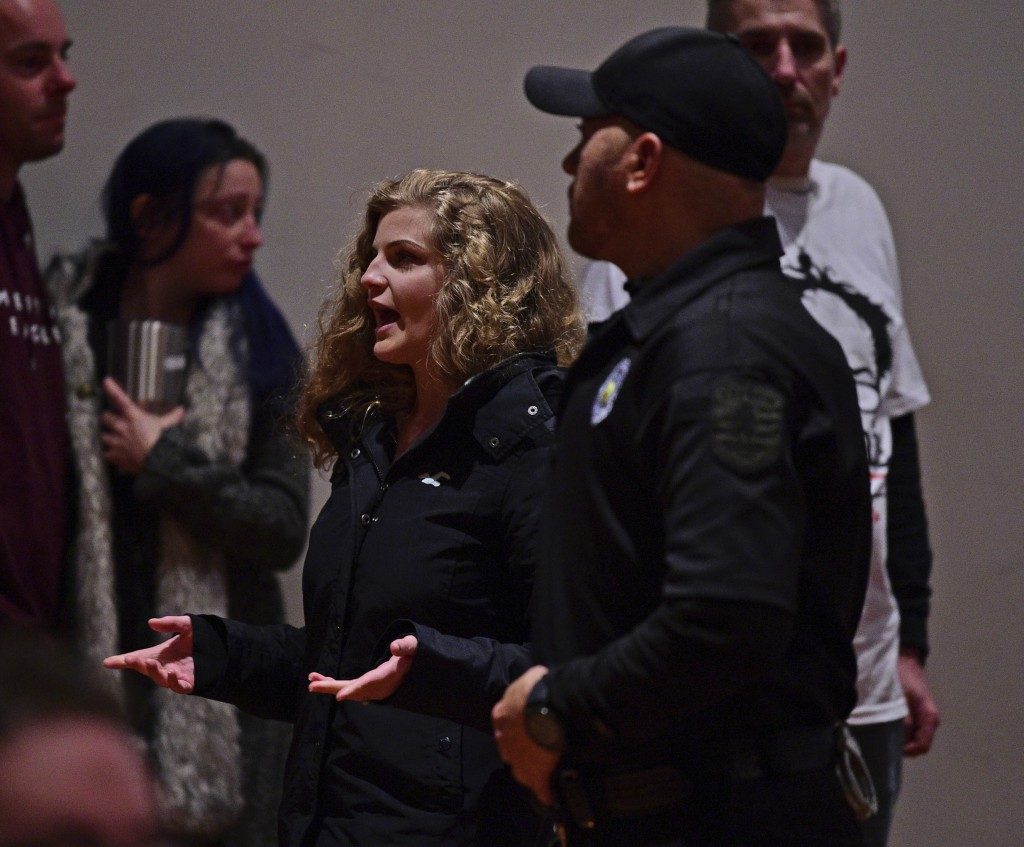 Protester Kaitlin Bennett is escorted out of the auditorium by police before Sen. Bernie Sanders, I-Vt., speaks at an Ohio workers town hall meeting,