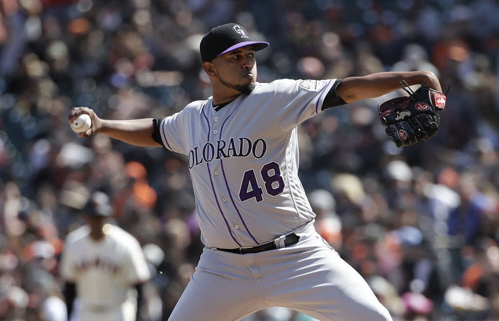 Colorado Rockies pitcher German Marquez throws against the San Francisco Giants during the seventh inning of a baseball game in San Francisco, Sunday,