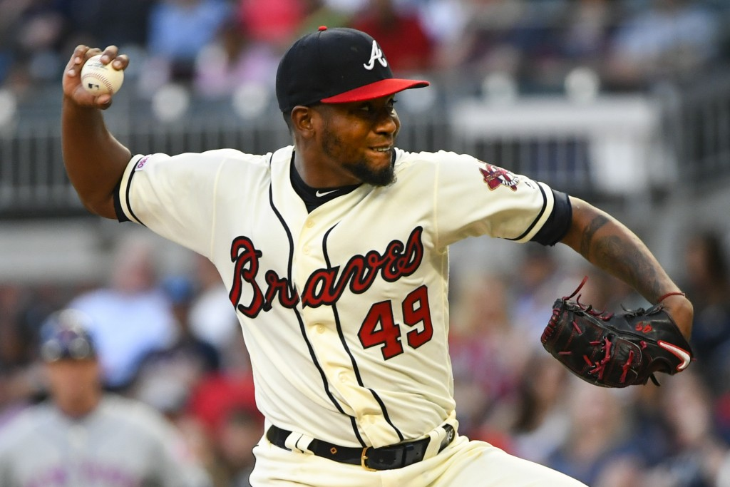 Atlanta Braves' Julio Teheran pitches against the New York Mets during the first inning of a baseball game Sunday, April 14, 2019, in Atlanta. (AP Pho