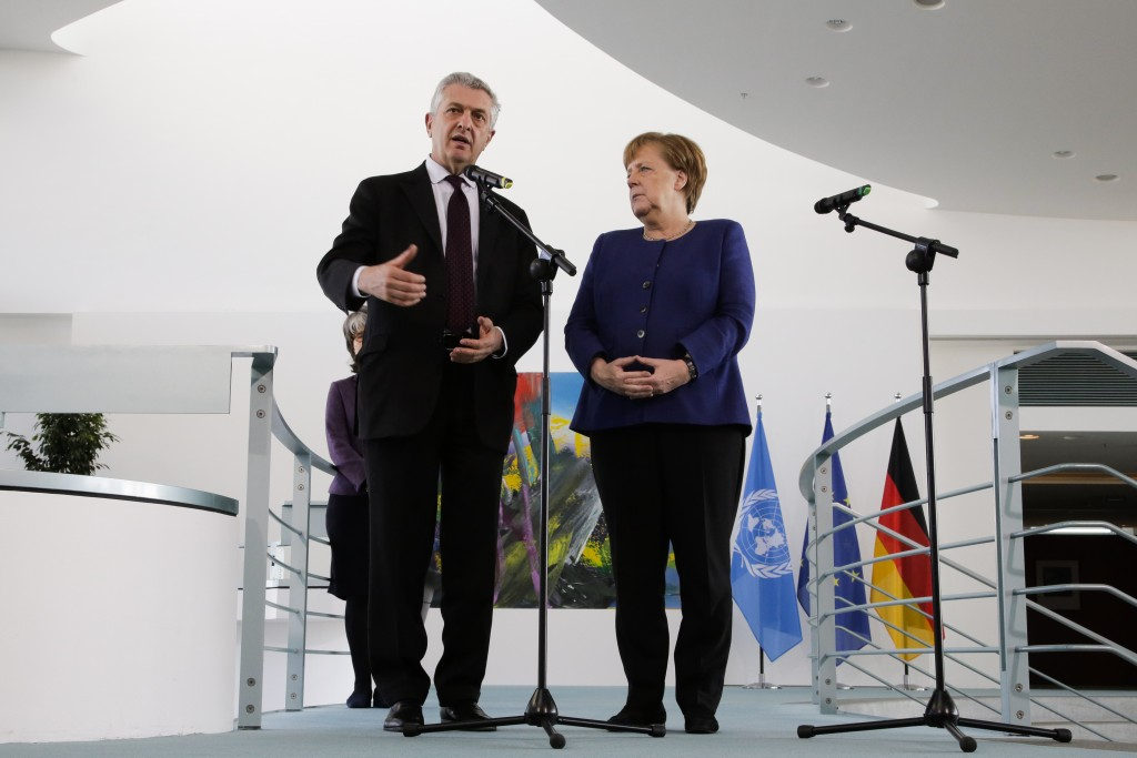 German Chancellor Angela Merkel, right, United Nations High Commissioner for Refugees Filippo Grandi, left, brief the media prior to a meeting at the