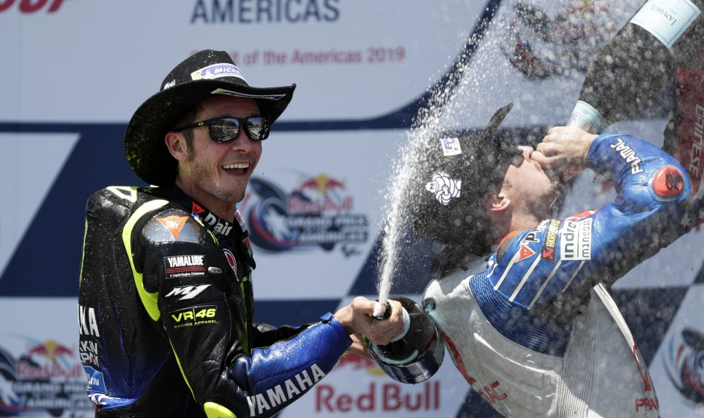 Valentino Rossi, left, of Italy, celebrates his second-place finish in the Grand Prix of the Americas motorcycle race at the Circuit of the Americas,
