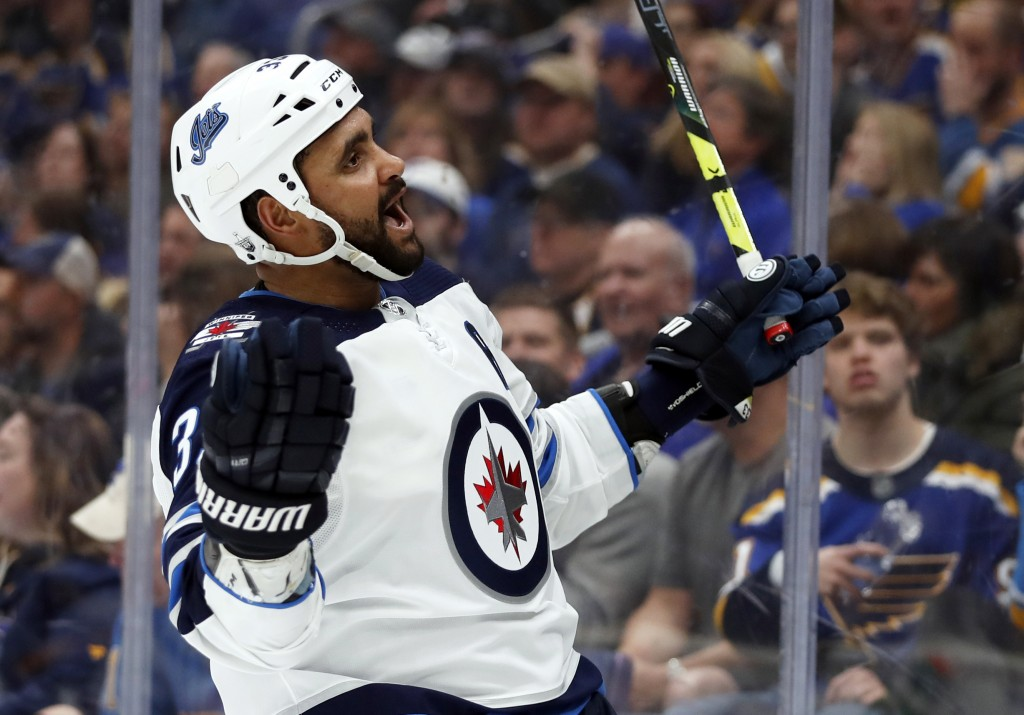 Winnipeg Jets' Dustin Byfuglien celebrates after scoring during the third period in Game 3 of an NHL first-round hockey playoff series against the St....