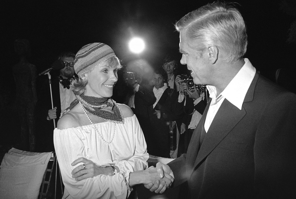 FILE - In this May 25, 1978 file photo, Swedish actress Bibi Andersson meets George Peppard at a party for the announcement of start of new U.S. film