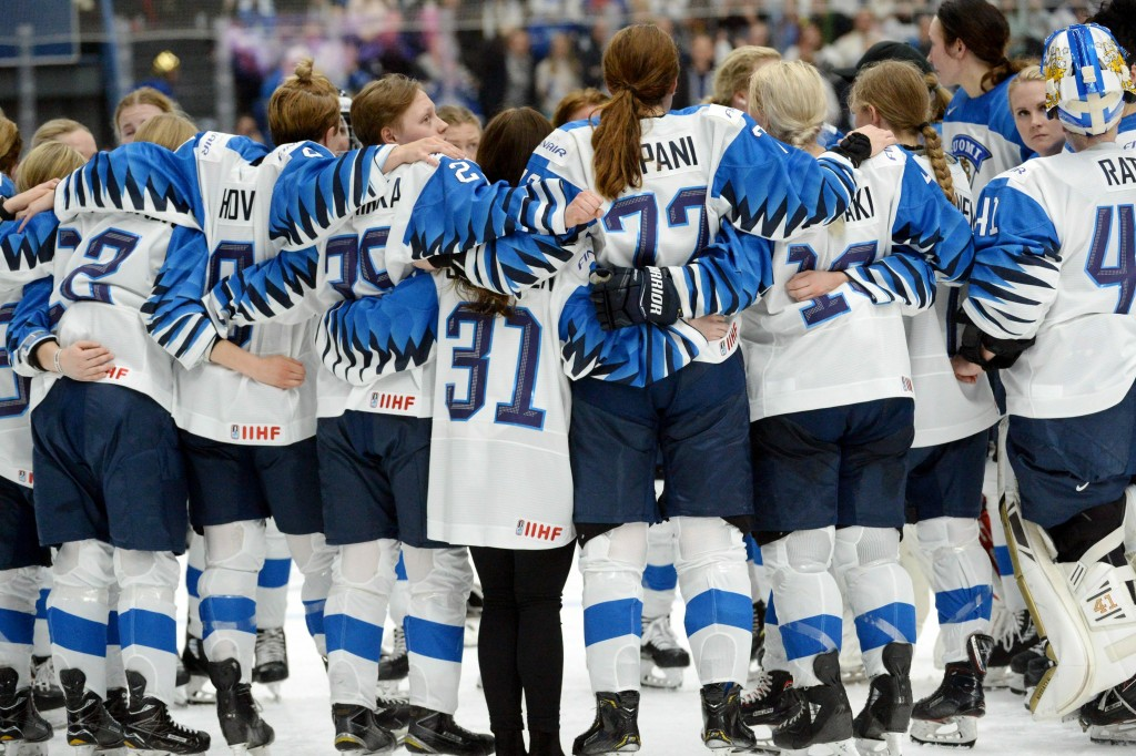Finnish players wait for the referee's decision after Finland scored a game-winning overtime goal which was later disallowed during the IIHF Women's I