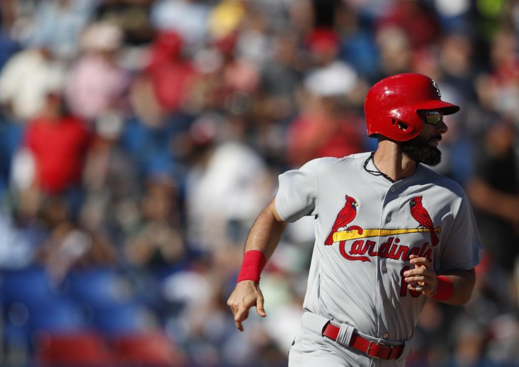 St. Louis Cardinals' Matt Carpenter watches his ball as he runs toward first after hitting a home run, during the seventh inning of a baseball game ag