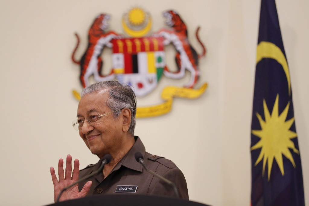Malaysian Prime Minister Mahathir Mohamad gestures during a press conference in Putrajaya, Malaysia, Monday, April 15, 2019. Malaysia's government dec