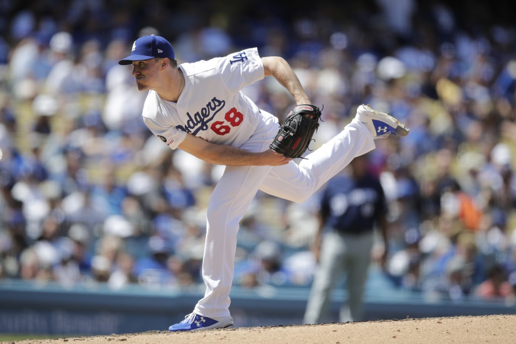 Los Angeles Dodgers starting pitcher Ross Stripling throws against the Milwaukee Brewers during the fourth inning of a baseball game, Sunday, April 14