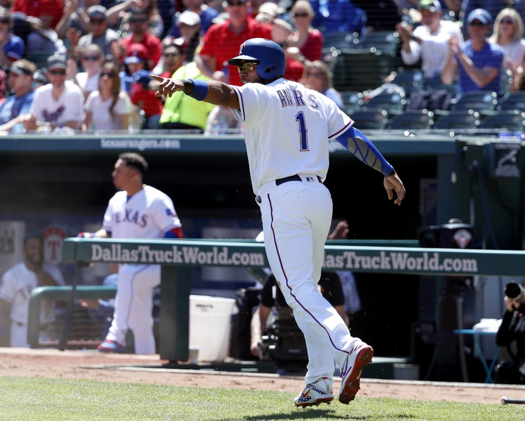 Texas Rangers' Elvis Andrus celebrates after  stealing home during a Logan Forsythe at-bat in the first inning of a baseball game against the Oakland ...