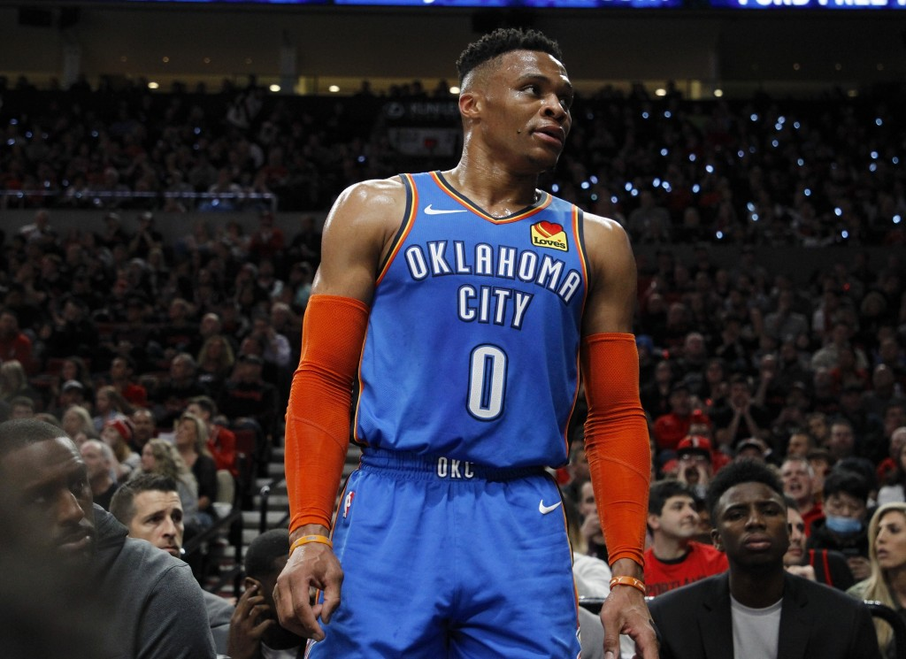 Oklahoma City Thunder guard Russell Westbrook interacts with the crowd during the first half of Game 1 of a first-round NBA basketball playoff series