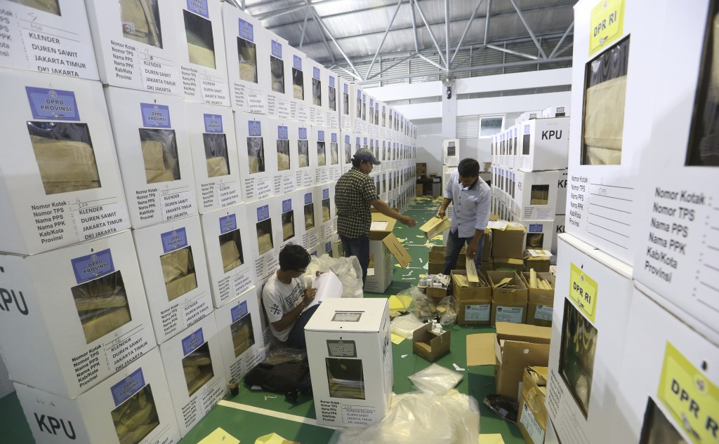 Workers prepare ballot boxes to be distributed to polling stations in Jakarta, Indonesia, Monday, April 15, 2019. The world's third-largest democracy