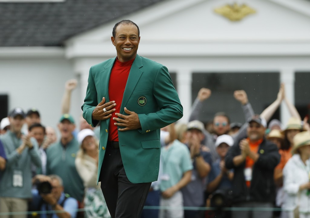 Tiger Woods smiles as he wears his green jacket after winning the Masters golf tournament Sunday, April 14, 2019, in Augusta, Ga. (AP Photo/Matt Slocu