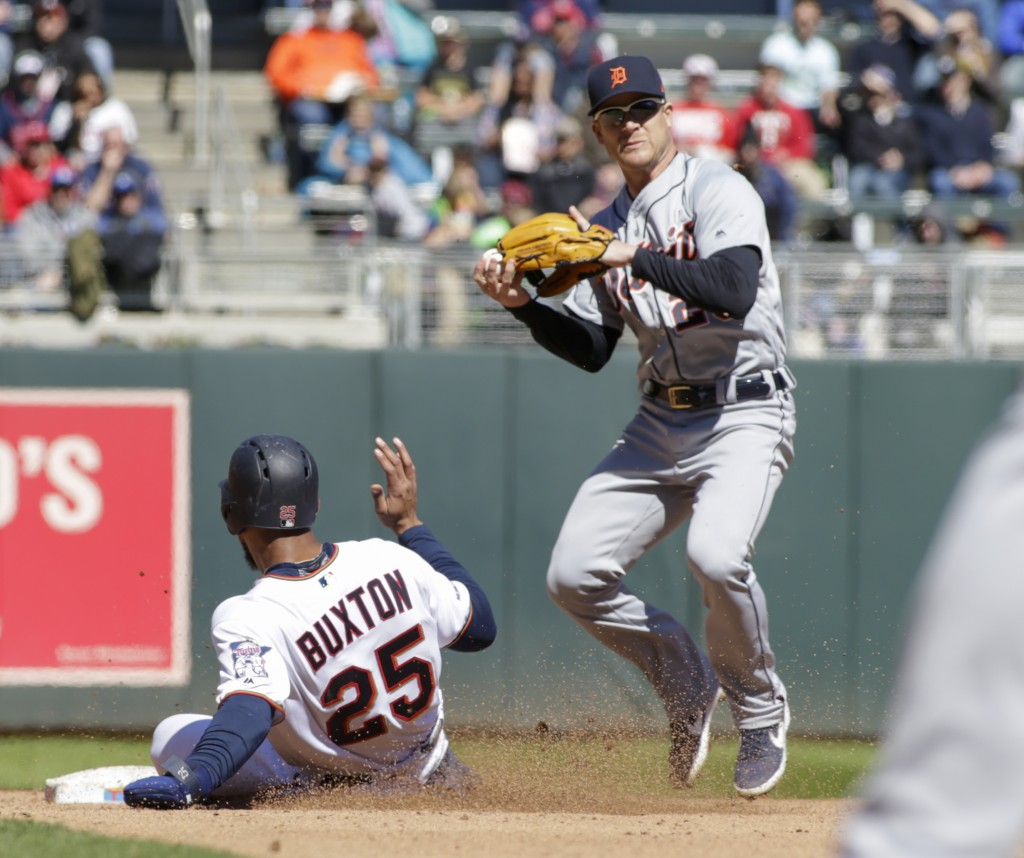 Minnesota Twins' Byron Buxton (25) is forced on the first half of a double-play by Detroit Tigers shortstop Gordon Beckham (29) during the fourth inni...