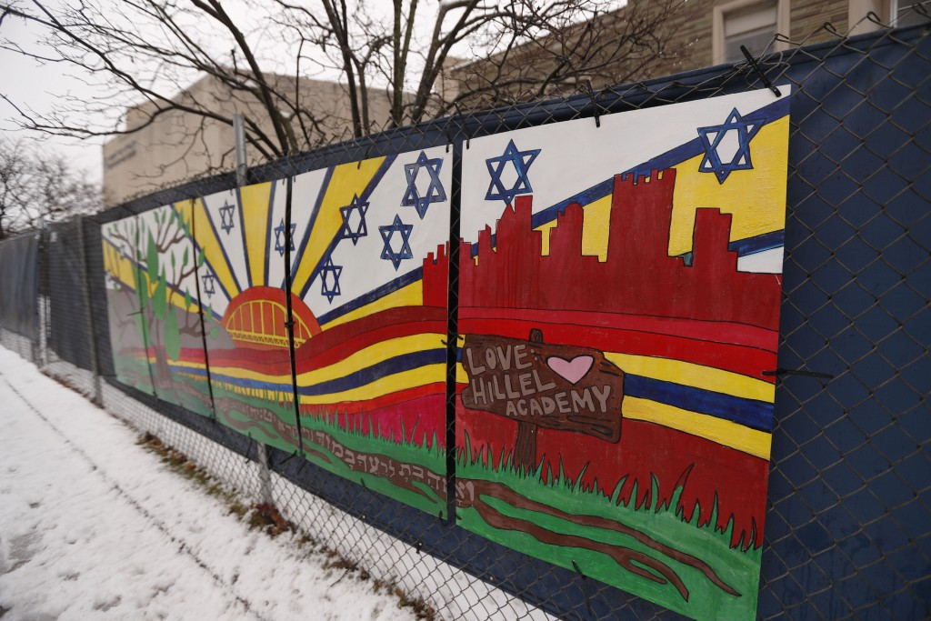 FILE--This file photo from Feb. 11, 2019 shows artwork on a fence around the Tree of Life Synagogue in Pittsburgh where 11 people were killed and seve