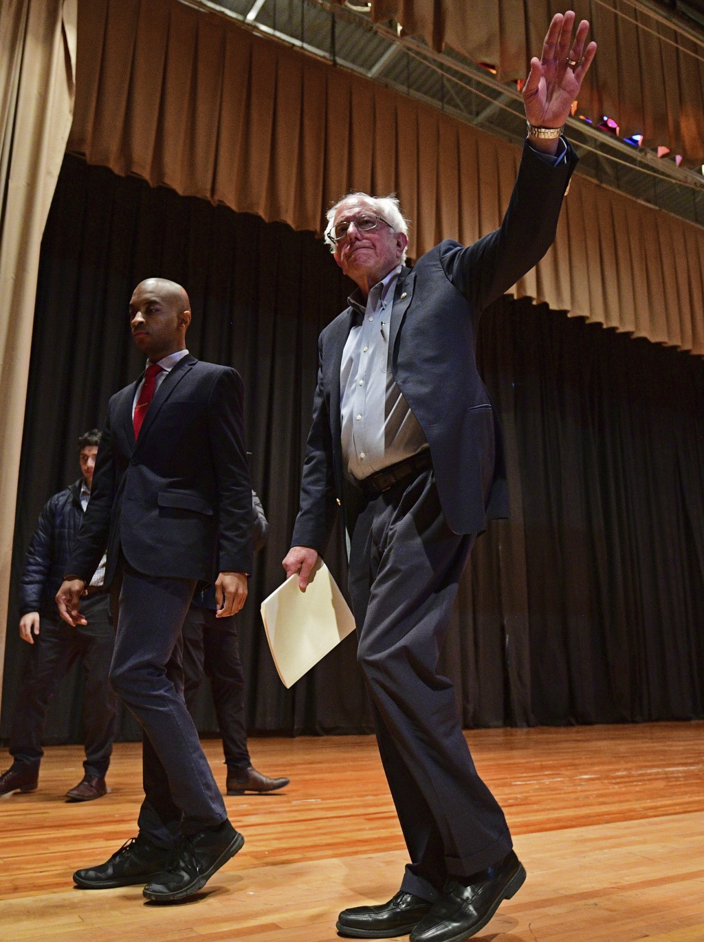 Sen. Bernie Sanders, I-Vt., exits the stage after speaking at an Ohio workers town hall meeting, Sunday, April 14, 2019, in Warren, Ohio. (AP Photo/Da