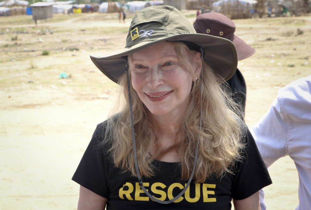 In this photo taken Tuesday, April 2, 2019, human rights activist Mia Farrow smiles while interacting with women and children in an internally displac