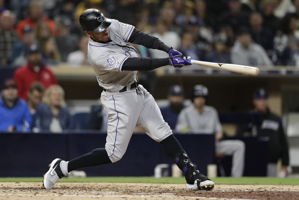 Colorado Rockies' Ian Desmond hits a home run during the seventh inning of a baseball game against the San Diego Padres, Monday, April 15, 2019, in Sa