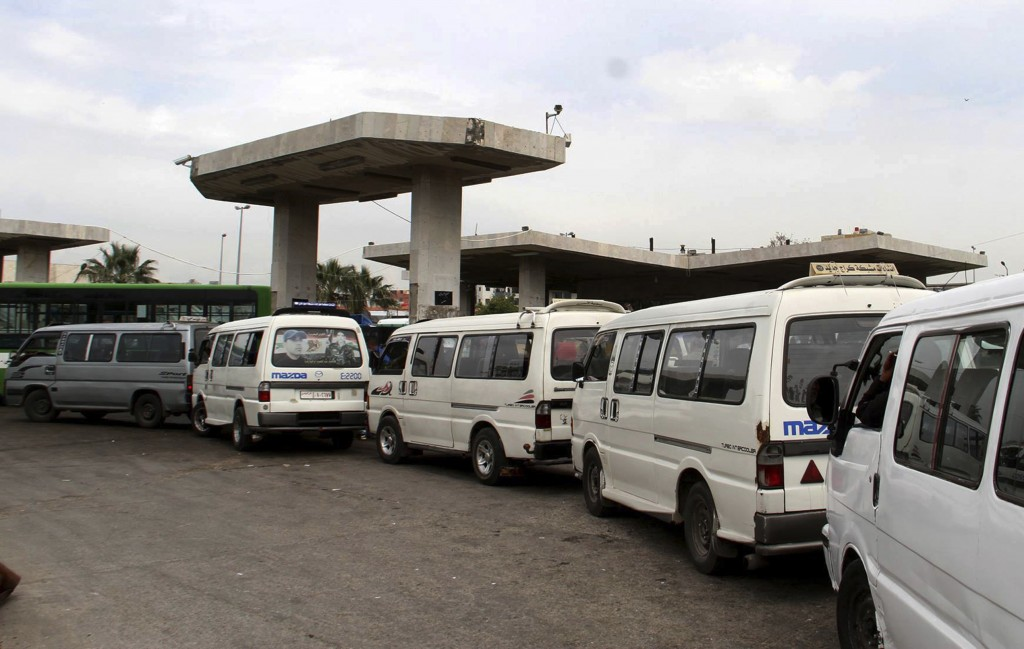 In this photo released on April 7, 2019, by the Syrian official news agency SANA, Shows vans queuing to fill their tanks with fuel, at a gas station i