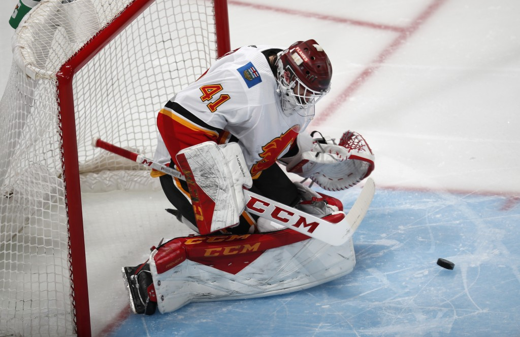 Calgary Flames goaltender Mike Smith stops a shot by the Colorado Avalanche in the first period of Game 3 of a first-round NHL hockey playoff series M