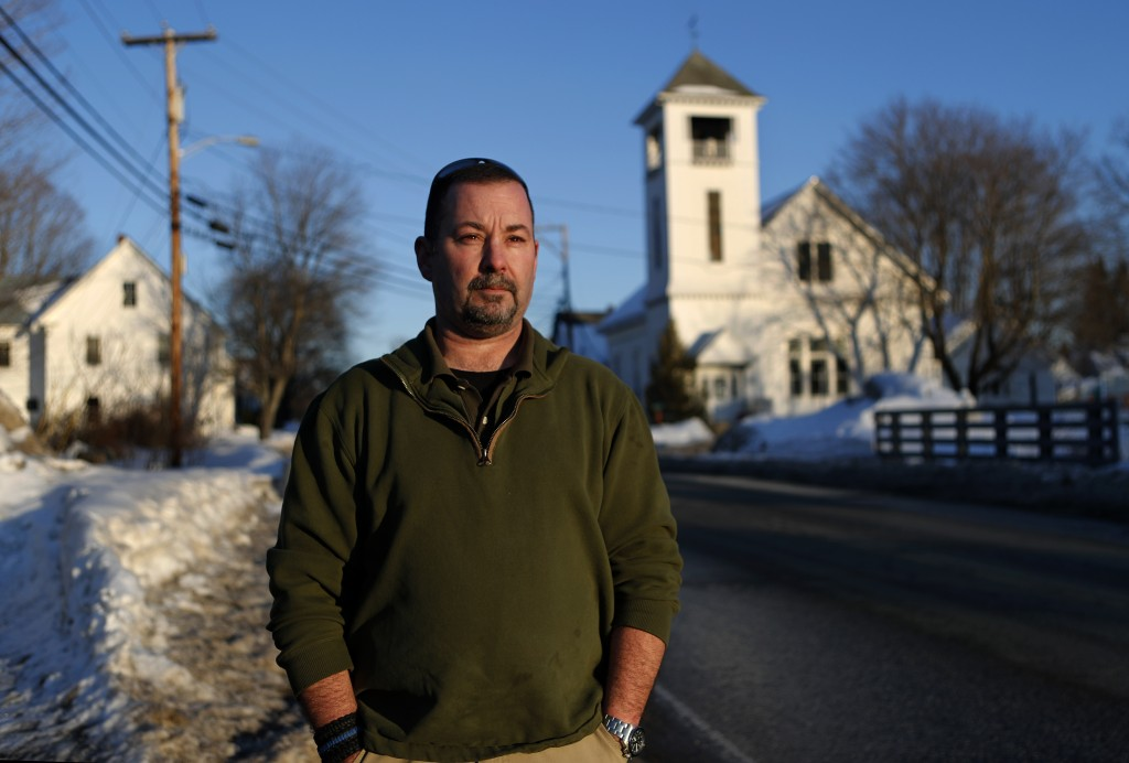 In this Tuesday, March 12, 2019 photo, former SWAT officer Al Joyce walks in Norway, Maine. Joyce left his job in law enforcement in Jefferson County,...
