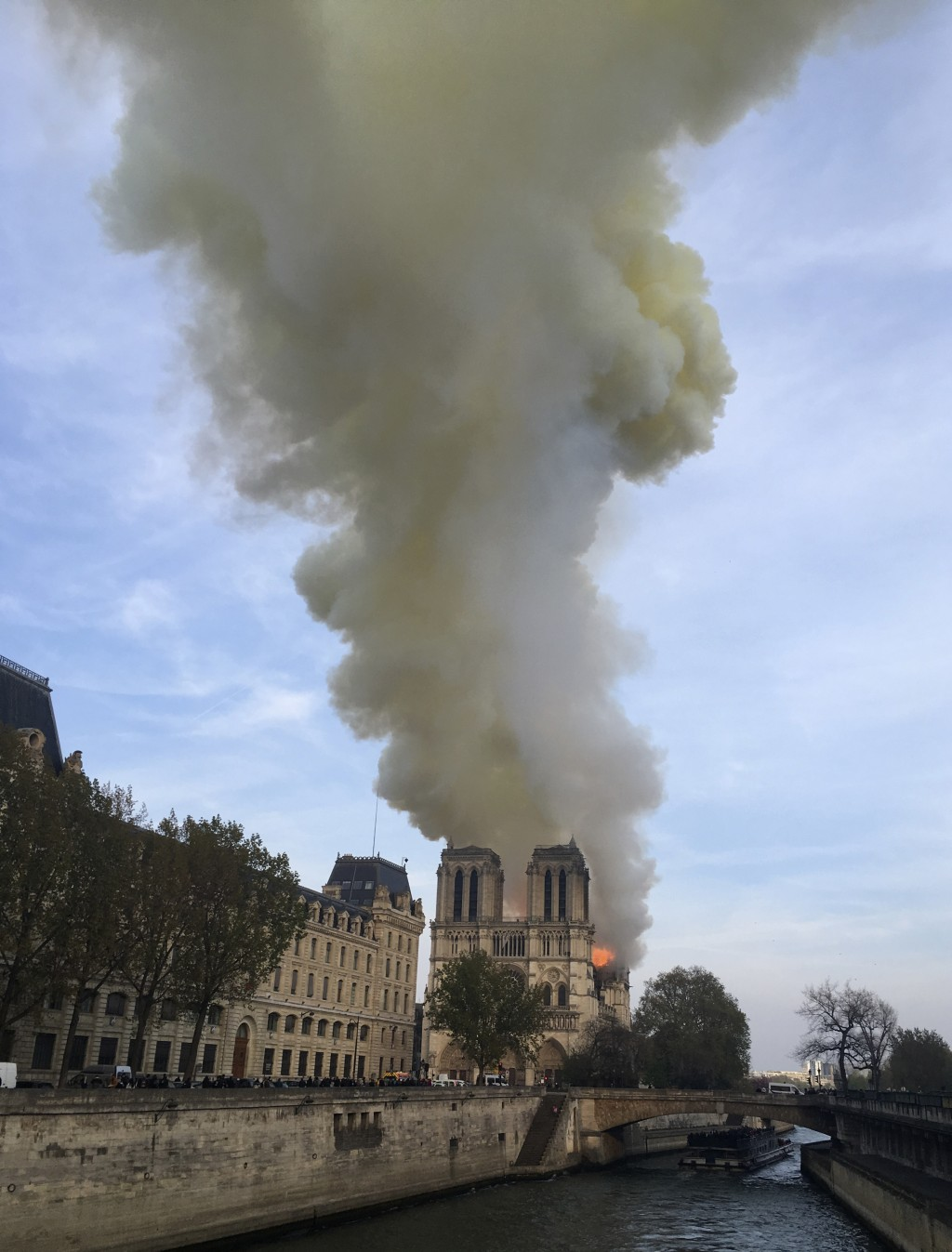 Notre Dame cathedral is burning in Paris, Monday, April 15, 2019. Massive plumes of yellow brown smoke is filling the air above Notre Dame Cathedral a