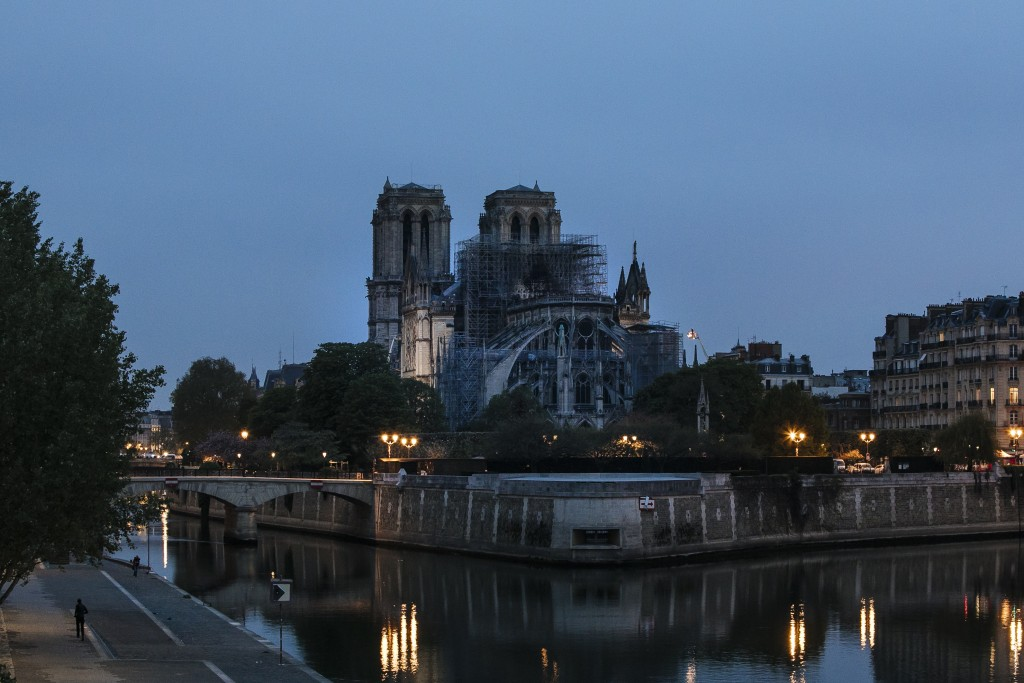 The Notre Dame cathedral is seen after the fire in Paris, Tuesday, April 16, 2019. A catastrophic fire engulfed the upper reaches of Paris' soaring No